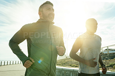 Buy stock photo Shot of two sporty men exercising together outdoors