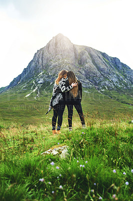 Buy stock photo Shot of two friends out exploring nature