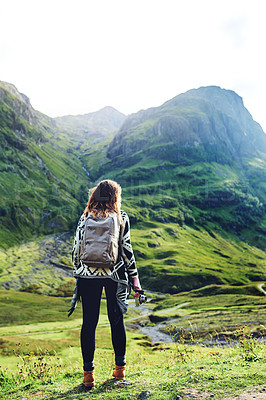 Buy stock photo Rearview shot of a young woman out hiking