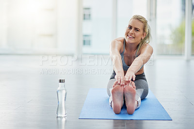 Buy stock photo Portrait of a sporty young woman exercising in a studio