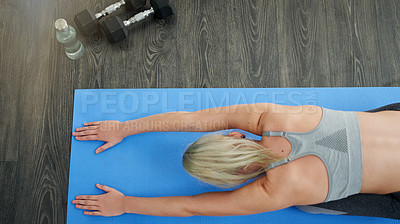 Buy stock photo High angle shot of a sporty young woman exercising in a studio