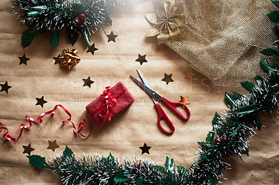 Buy stock photo Shot of a Christmas gift wrapped in red wrapping paper and scissors
