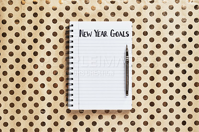 "Buy stock photo Shot of a notebook with the words ""New year goals"" written on it"