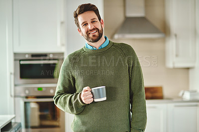Buy stock photo Cropped shot of a handsome young man drinking coffee at home