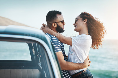 Buy stock photo Shot of a young couple enjoying a summer's road trip together