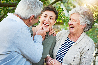 Buy stock photo Cropped shot of an attractive young woman visiting her senior parents over the weekend