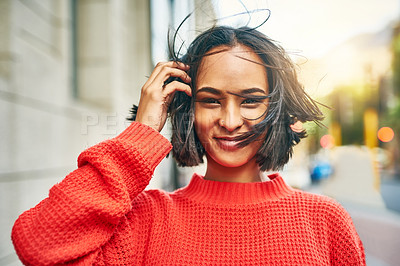 Buy stock photo Cropped shot of an attractive young woman out in the city