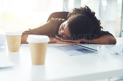Buy stock photo Shot of a young businesswoman sleeping with her head down on her office desk