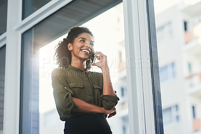 Buy stock photo Shot of a young businesswoman making a phone call in her office