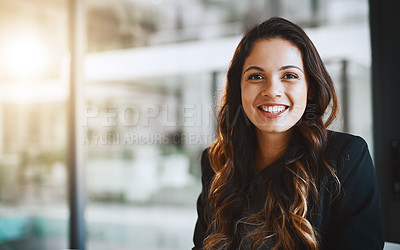 Buy stock photo Cropped portrait of an attractive young businesswoman working in her office