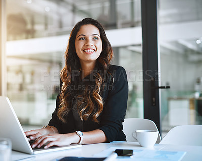 Buy stock photo Cropped shot of an attractive young businesswoman looking thoughtful while working on her laptop in the office