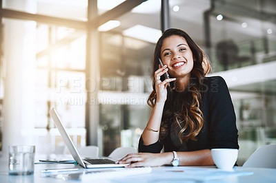 Buy stock photo Cropped portrait of an attractive young businesswoman making a phonecall while working in her office