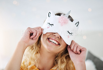 Buy stock photo Cropped shot of an attractive young woman wearing a sleeping mask while relaxing in her bedroom at home