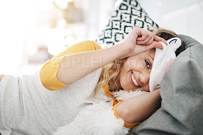 Buy stock photo Cropped portrait of an attractive young woman wearing a sleeping mask while relaxing in her bedroom at home