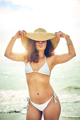 Buy stock photo Cropped shot of an attractive young woman pouting while standing on the beach