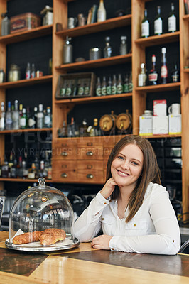 Buy stock photo Shot of a confident young woman working in a coffee shop