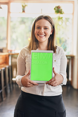 Buy stock photo Cropped shot of a young woman holding up a digital tablet with a green screen