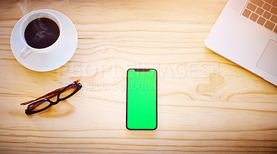 Buy stock photo High angle shot of a smartphone displaying chroma key on the screen in an office environment