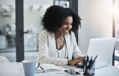 Buy stock photo Shot of a young businesswoman working and in good spirits at her office desk