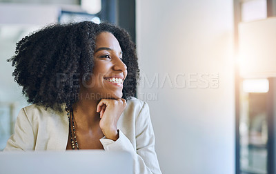 Buy stock photo Shot of a young businesswoman smiling and looking out of a window while sitting at her office desk