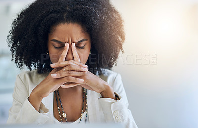 Buy stock photo Shot of a young businesswoman looking stressed out in her office