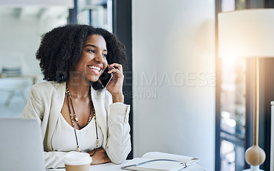 Buy stock photo Shot of a young businesswoman taking a phone call at her office desk