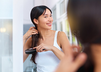 Buy stock photo Cropped shot of an attractive young woman in her bathroom at home