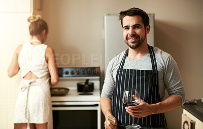 Buy stock photo Cropped portrait of a handsome young man and his girlfriend preparing food together at home