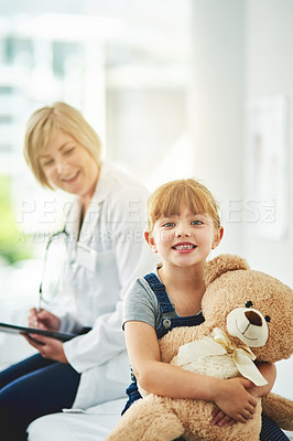 Buy stock photo Cropped shot of an adorable little girl at the doctor's office