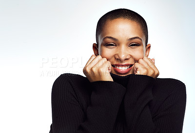 Buy stock photo Cropped shot of an attractive young woman posing against a grey background