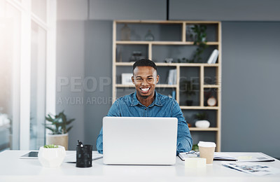 Buy stock photo Shot of a young handsome businessman in a modern office