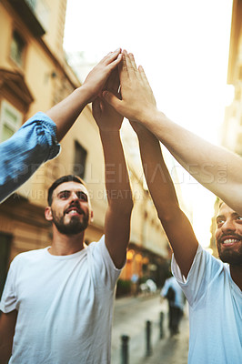 Buy stock photo Cropped shot of a group of friends joining their hands together outdoors