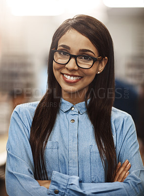 Buy stock photo Portrait of a university student standing in the library at campus