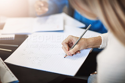 Buy stock photo Closeup shot of a university student writing notes in her book