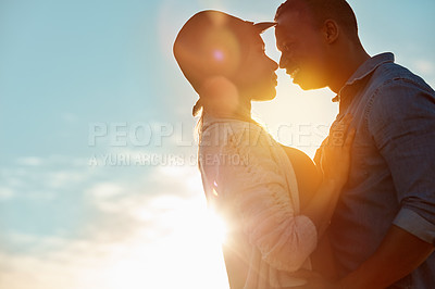 Buy stock photo Shot of a happy young couple sharing a romantic moment outdoors