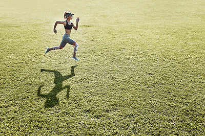 Buy stock photo Full length shot of an attractive and athletic young woman running across an open field