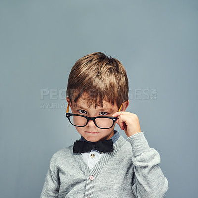 Buy stock photo Studio portrait of a smartly dressed little boy posing with attitude against a gray background