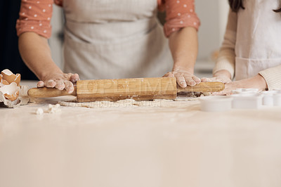 Buy stock photo Cropped shot of unrecognizable people baking at home