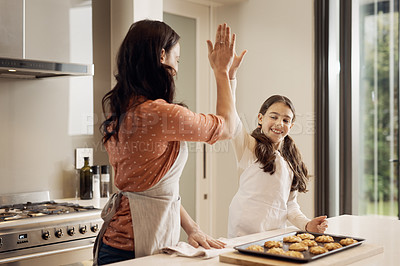 Buy stock photo Shot of an adorable little girl and her mother having fun while baking at home
