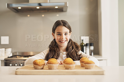 Buy stock photo Shot of a young girl with some freshly baked muffins