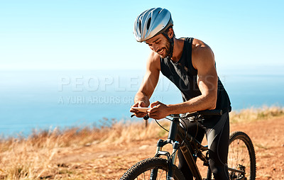 Buy stock photo Cropped shot of a male cyclist out for a ride on his mountain bike