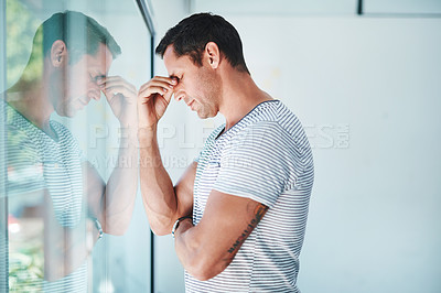 Buy stock photo Shot of a mature businessman looking stressed out in an office