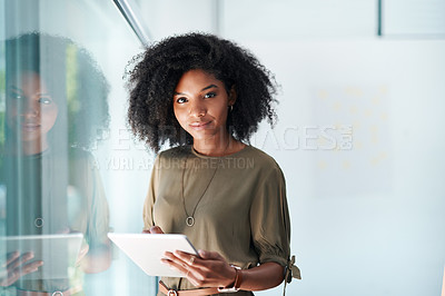 Buy stock photo Portrait of a young businesswoman using a digital tablet in an office