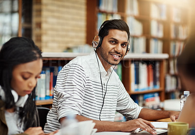 Buy stock photo Cropped shot of students studying in the library