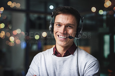 Buy stock photo Cropped portrait of a handsome young businessman working late in a call center