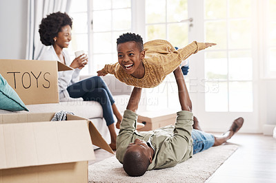Buy stock photo Shot of a happy family having fun while moving house