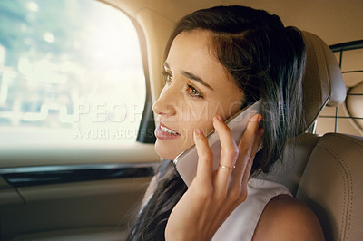 Buy stock photo Closeup shot of an attractive young businesswoman sitting inside a car and making a phone call while travelling to work