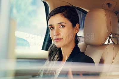 Buy stock photo Portrait of an attractive young businesswoman sitting inside a car while travelling to work