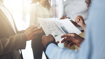 Buy stock photo Closeup shot of a group of businesspeople going through paperwork in an office