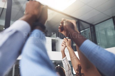 Buy stock photo Closeup shot of a group of businesspeople holding hands in an office